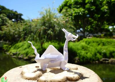 Origami Dragon placed at stone in Hawaii