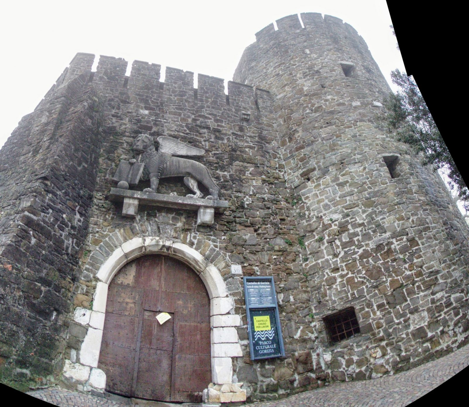 castle entrance gate with statue on the gate